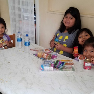 Kids eating at their table